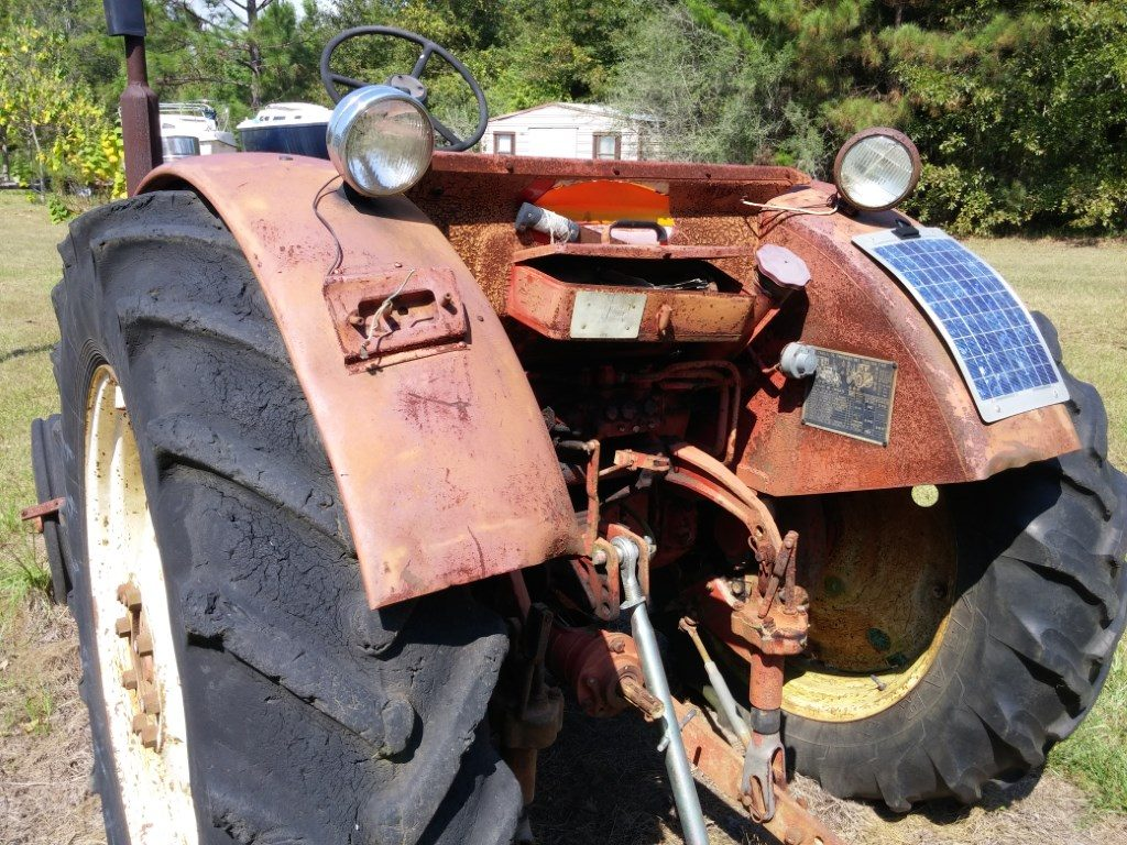 Old tractor keeps a hot battery with solar power.
